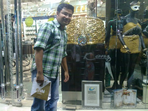 Writer in front of the world`s biggest gold ring in Deira, Dubai.